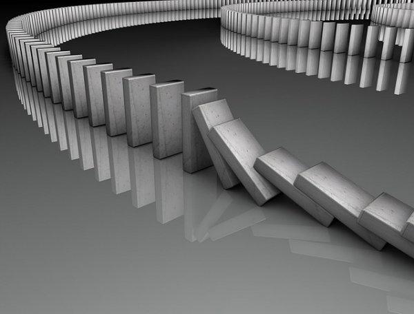 Série de dominós caindo em efeito borboleta.